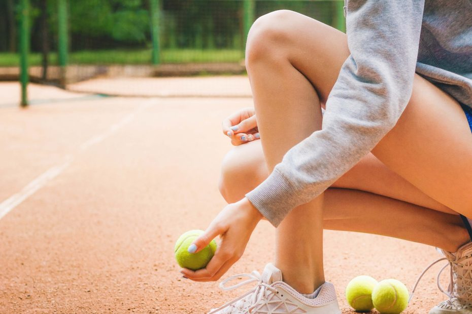 Tennis Player holding tennis balls.